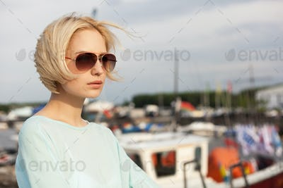 Pretty girl on the sea background