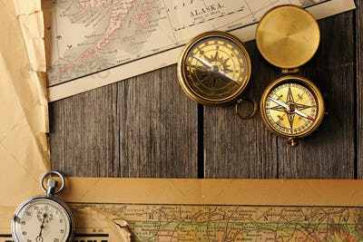 Antique compasses over old map
