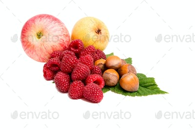 Fresh autumn fruits on a white.