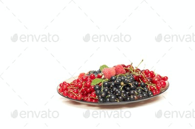 Tasty berries at the brown plate.