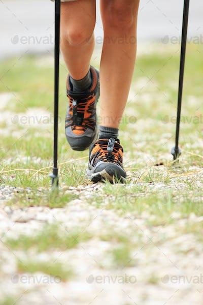 Nordic walking legs in mountains