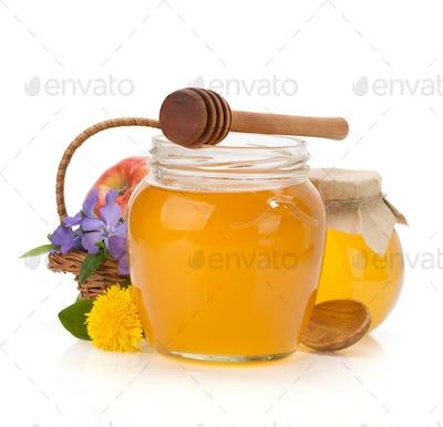 glass jar full of honey and stick
