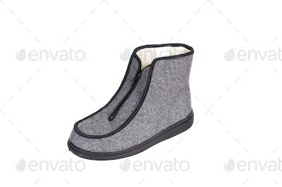 Winter gray boot on a white