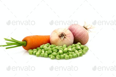 Green peas,onions and carrot isolated on a whiteground.