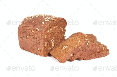 Bread full of seeds  on a white background.