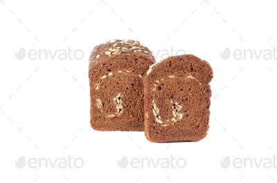 Rye bread full of seeds on a white background.
