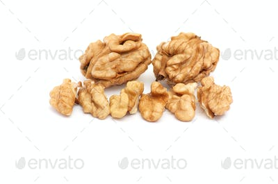 Pieces of walnuts on a white.