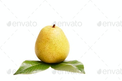 Juicy pear and green leaves on a white.