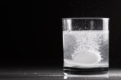 Effervescent Pill in a Glass of Water