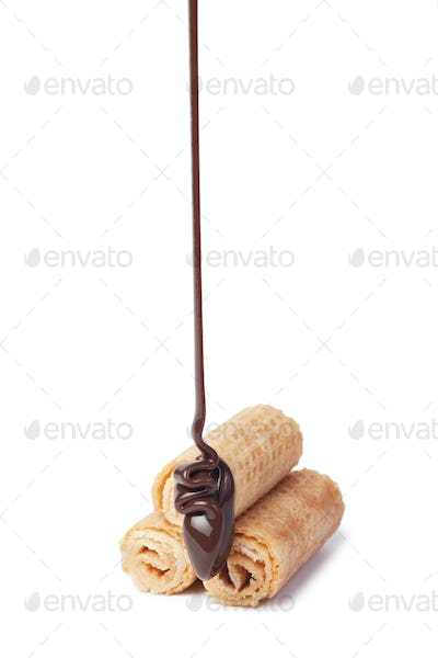 Chocolate Pouring Onto Waffle Roll Isolated Over White