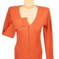 Elegant orange jumper  on a white.