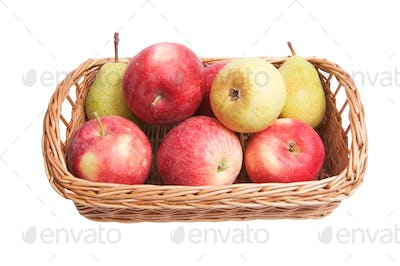 Autumnal  basket with fruits on a white