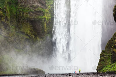 Tourists in front of Skogafoss waterfall