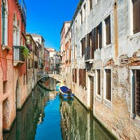 Venice cityscape, water canal and traditional buildings. Italy