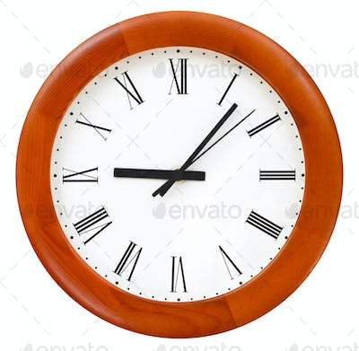 six minutes past nine on round dial