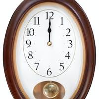 midnight on oval wall clock