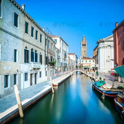 Venice San Barnaba cityscape, water canal, church and boats. Ita