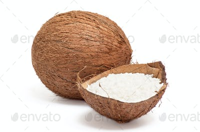 Part of coconut with powder inside shell .