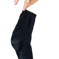 Hand holding dirty black sock