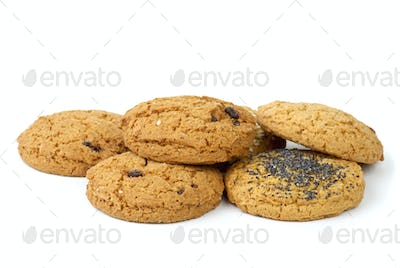 Few oatmeal cookies (with raisins, sesame and poppy seeds) isolated on the white background
