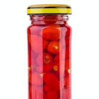 Glass jar with marinated Piri-Piri peppers