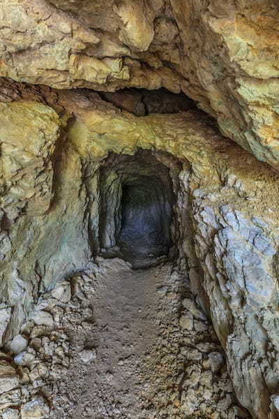 old tunnel through mountain rock