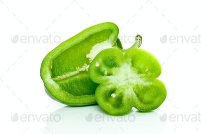 Half of green sweet pepper and flower-shaped slice