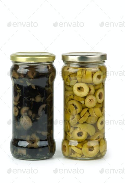 Glass jar with sliced green and black olives