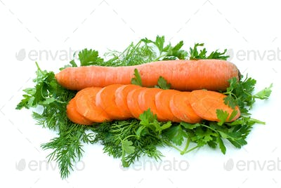 Whole carrot and few slices over some dill and parsley