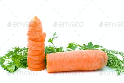 Half of ripe fresh carrot and slices and some parsley