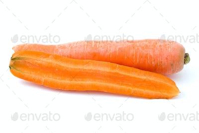 Ripe fresh long carrot and half