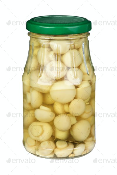 Glass jar with marinated white mushrooms