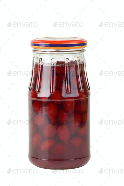 Glass jar with jam maded from cornelian cherries