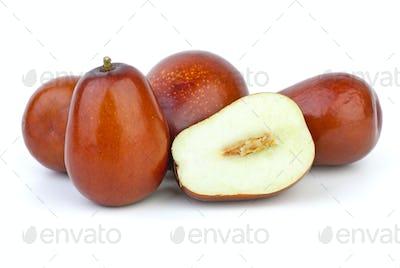 Whole and sliced unabi berries