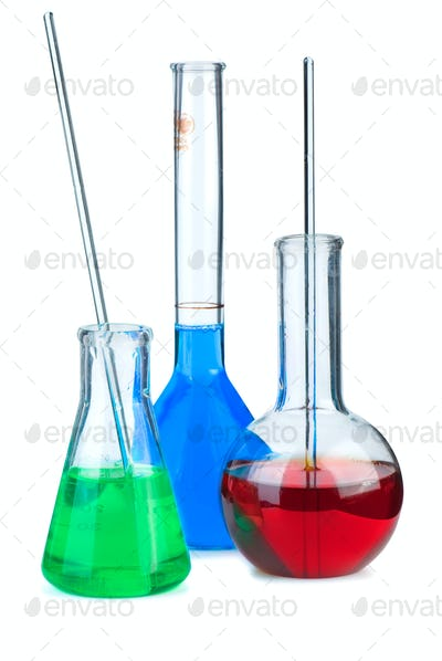 Three flasks with different chemical agents