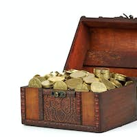 Old wooden chest with golden coins