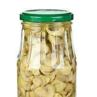 Glass jar with sliced marinated white mushrooms