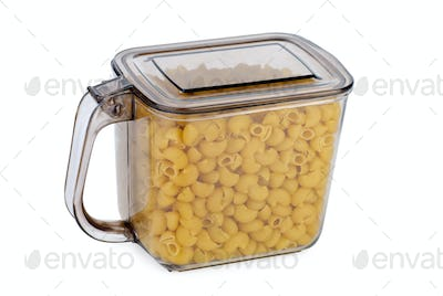 Kitchen container ful of uncooked macaroni