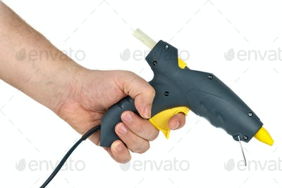 Hand holding glue gun