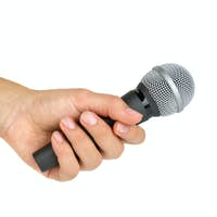 Interview: hand with microphone