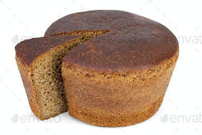 Round loaf of rye bread with piece cut