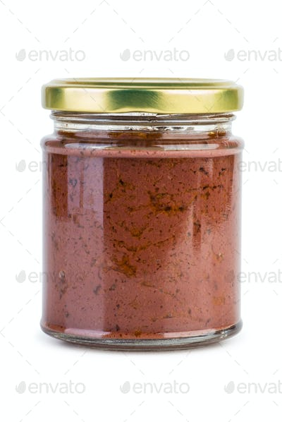 Glass jar with paste maded from red olives (Calamata)