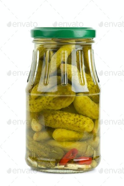 Glass jar with marinated cornichons