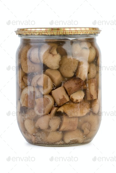 Glass jar with marinated birch boletuses