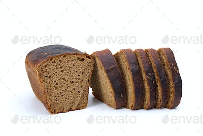 Chunk of rye bread with anise and some slices
