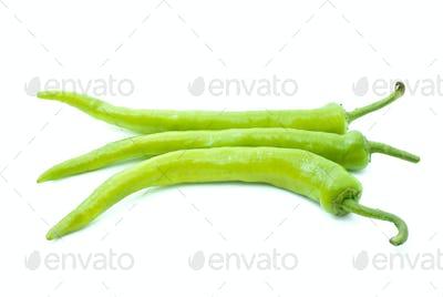 Three yellow-green chili peppers