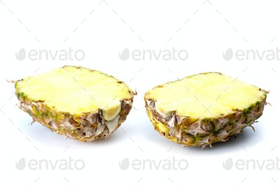 Two pineapple halves