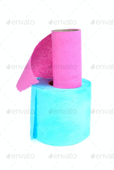 Finished roll of pink and full roll of blue toilet paper