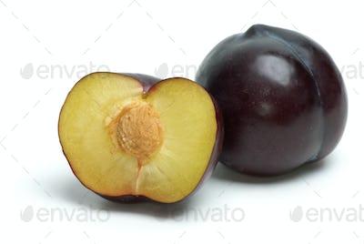 Whole plum and half