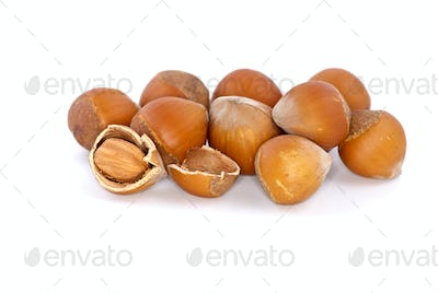 Small pile of hazelnuts and one cracked